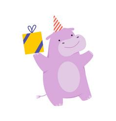 Cartoon hippo with a gift on vector