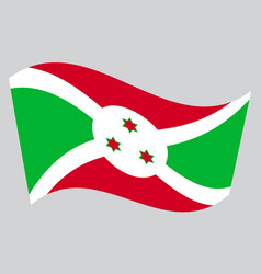 Flag of burundi waving on gray background vector