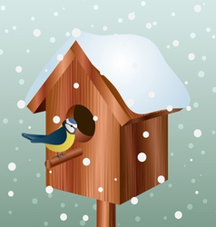 Winter bird house with little bird vector image