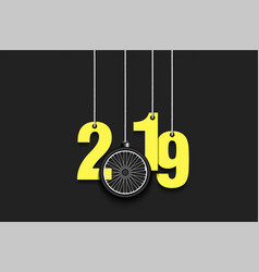 2019 new year and bicycle wheel hanging on strings vector