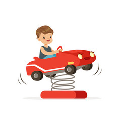 cute little boy having fun on red plastic rocking vector image