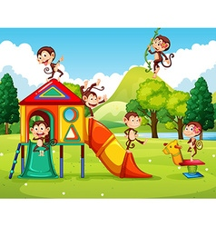 Monkeys playing in the playground vector