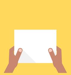 two dark-skinned hands holding white sheet vector image