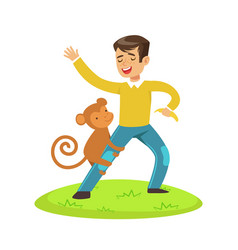 cute happy boy standing and playing with monkey vector image vector image