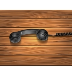 Handset On Wooden Background vector