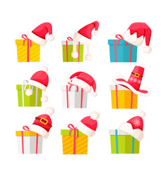 set of gift boxes with santa claus caps on white vector image