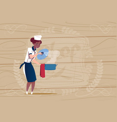 female african american chef cook holding pot vector image