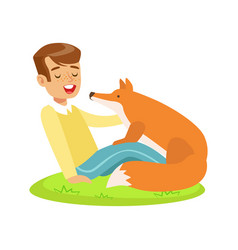smiling boy sitting on green grass and petting red vector image vector image