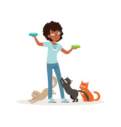 Cute curly-haired girl feeding homeless cats vector