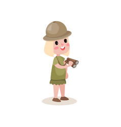 flat little girl scout character holding vector image