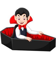 cartoon happy vampire in his coffin vector image