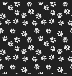 Dog paw print dark seamless pattern vector