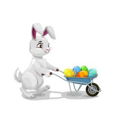 Easter holiday bunny with wheelbarrow and eggs vector