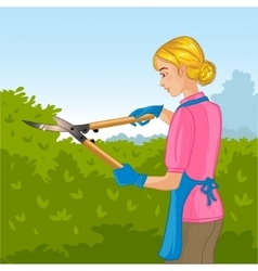 Woman trimming a bush or tree with big clippers vector image