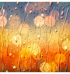 Autumn background view through wet glass vector image