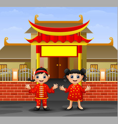 cartoon chinese kids in front of the temple vector image