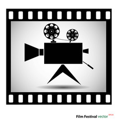 movie camera at film strip isolated on a white bac vector image