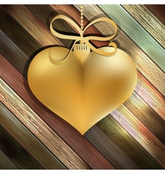 Gold heart on wooden background EPS10 vector image vector image