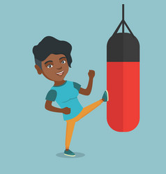 Young african woman exercising with punching bag vector