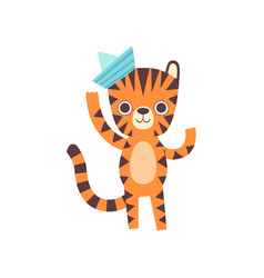 cute little tiger in paper cap waving its paw vector image