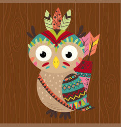 Tribal owl on wooden background vector
