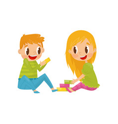 little kids playing with colorful cubes brother vector image