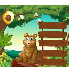 Bear sitting next to wooden signs in jungle vector