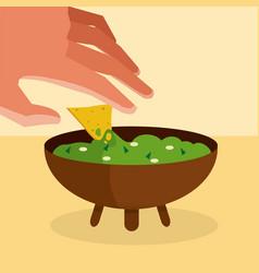Hand grabbing nacho with guacamole vector