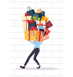 Man holding gift boxes stack over white brick wall vector