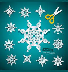 paper cut snowflakes set with scissors on blue vector image vector image