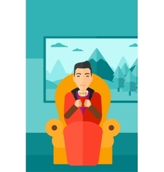 Man sitting in chair with cup of tea vector image