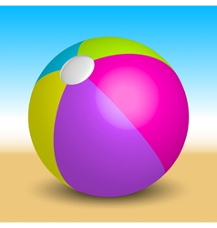 inflatable beach ball on the beach vector image vector image