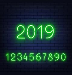 glowing neon numbers set on brick wall vector image
