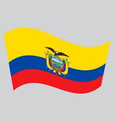 flag of ecuador waving on gray background vector image vector image