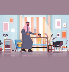 Arab father playing with little son in crib vector