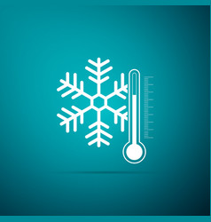 thermometer with snowflake icon on blue background vector image
