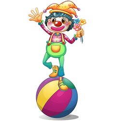A clown balancing above a ball vector image vector image
