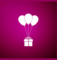 gift box with balloons icon on purple background vector image
