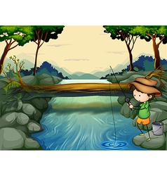 A boy fishing at the river vector image