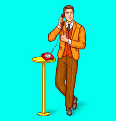 pop art man talking on a retro phone and shows the vector image
