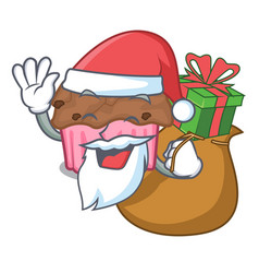 santa with gift chocolate muffins on a mascot vector image