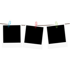 Three blank polaroid frames hanging on a rope vector