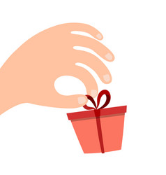 gift box with a bow on his hand vector image