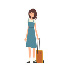 Beautiful young woman standing with suitcase on vector