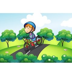A boy riding in his bike vector