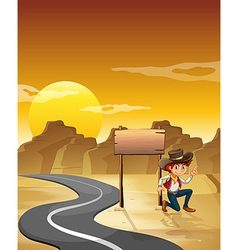 A man beside an empty board near the road vector image vector image