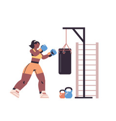 female boxer doing exercises with punching bag vector image
