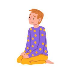 Slumber party cute boy sitting on floor wearing vector