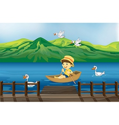 A boy riding on a wooden boat vector image
