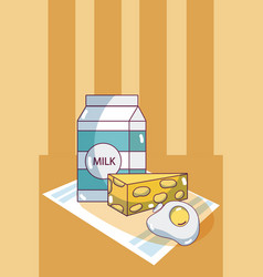Milk box and cheese vector
